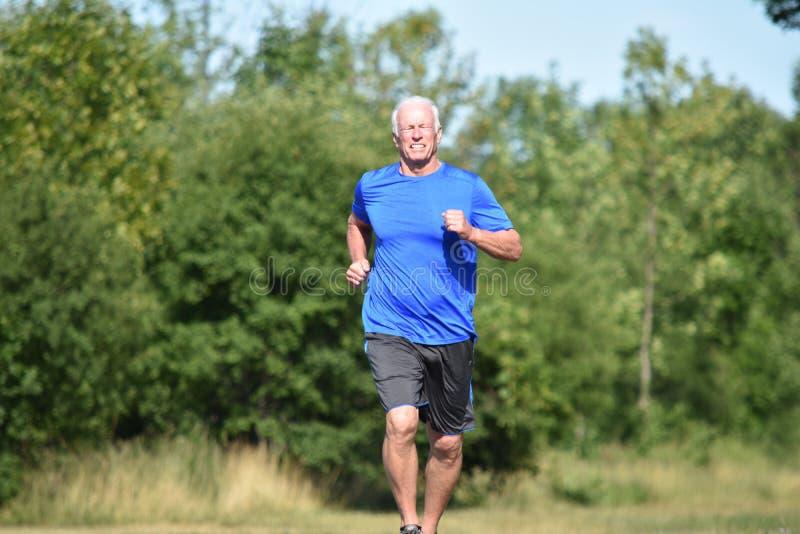 Gelukkige Mannelijke Hogere Grampa-Jogging royalty-vrije stock foto's