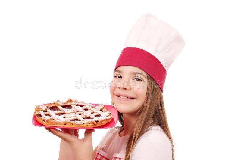 Gelukkige meisjekok met kersenpastei royalty-vrije stock afbeelding