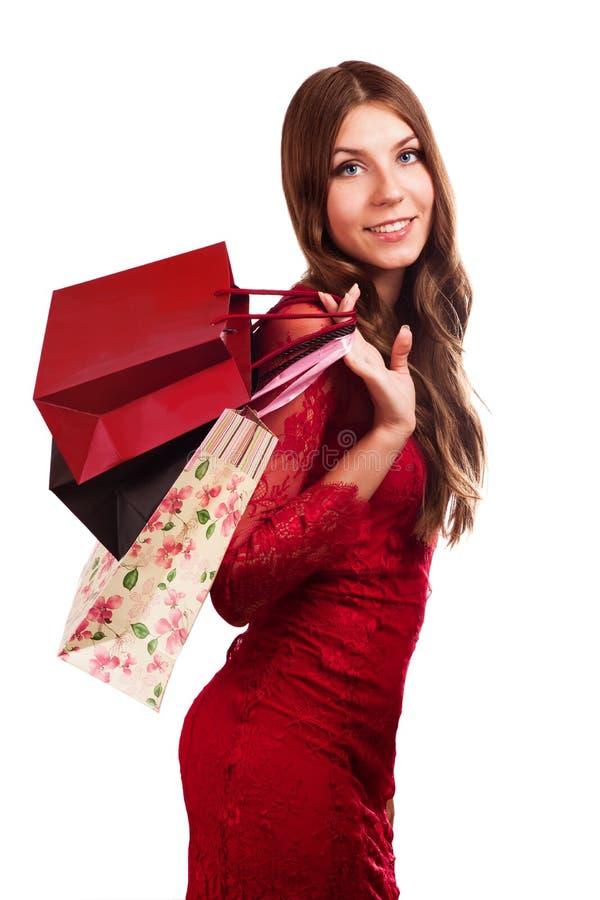 Gelukkige meisjesgreep het winkelen zak. royalty-vrije stock afbeeldingen