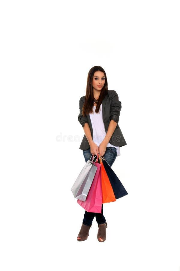 Gelukkige meisjesholding het winkelen zakken stock foto