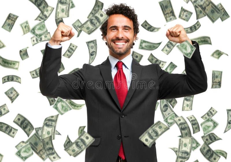 Gelukkige mens die van de regen van geld genieten stock foto