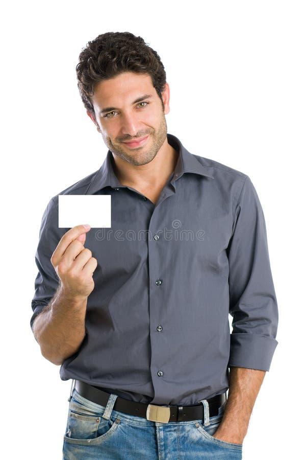 Gelukkige mens met witte kaart royalty-vrije stock afbeelding