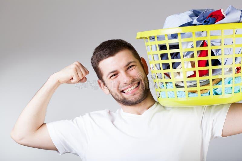 Gelukkige mensen doingg wasserij royalty-vrije stock afbeeldingen