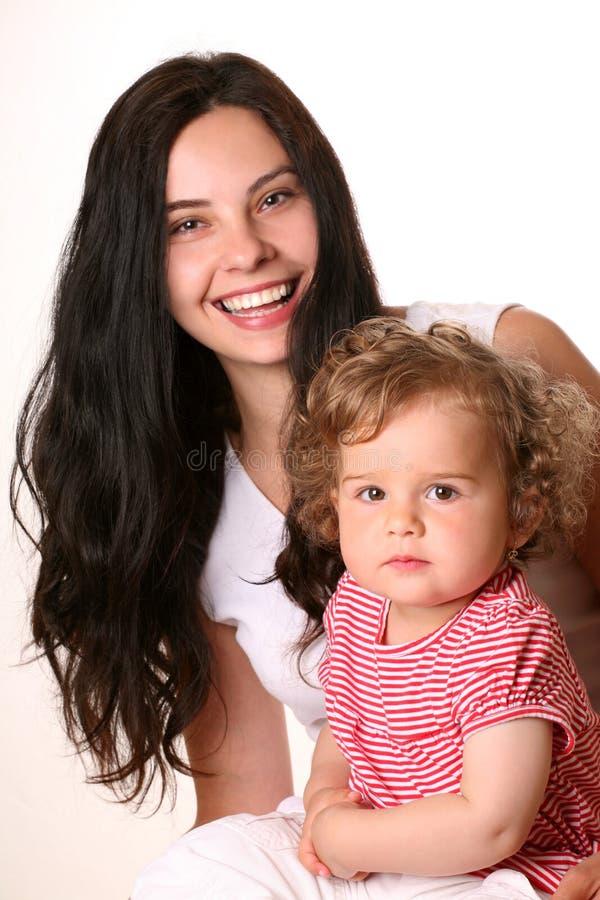 Gelukkige moeder met kind stock afbeeldingen