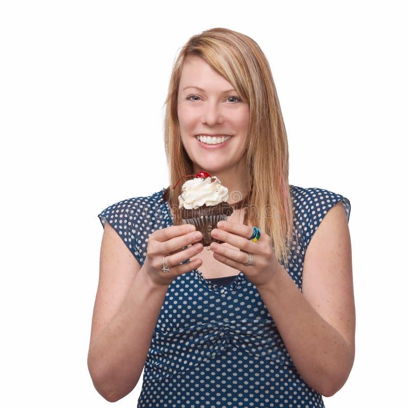 Vrouw met cupcake stock foto's