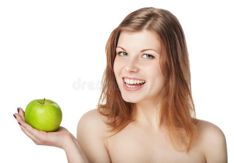 Gelukkige mooie jonge vrouw met appel stock afbeeldingen