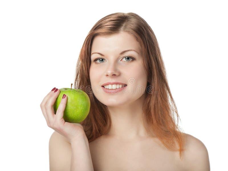 Gelukkige mooie jonge vrouw met appel stock foto's