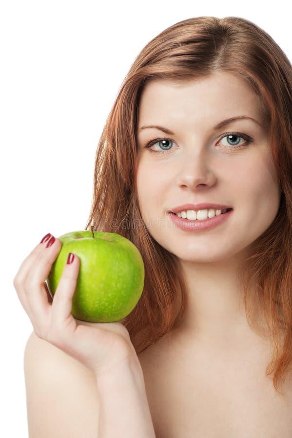 Gelukkige mooie jonge vrouw met appel stock fotografie