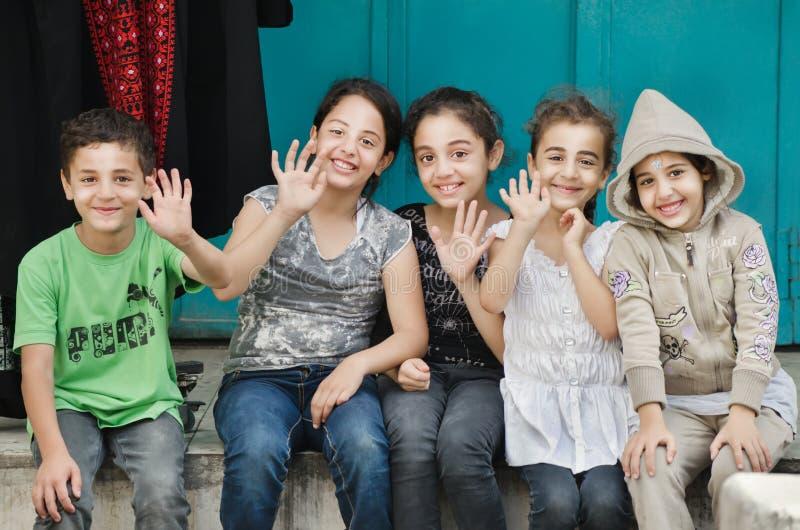 Gelukkige, mooie, welkom hetende kinderen van Palestina. royalty-vrije stock afbeeldingen