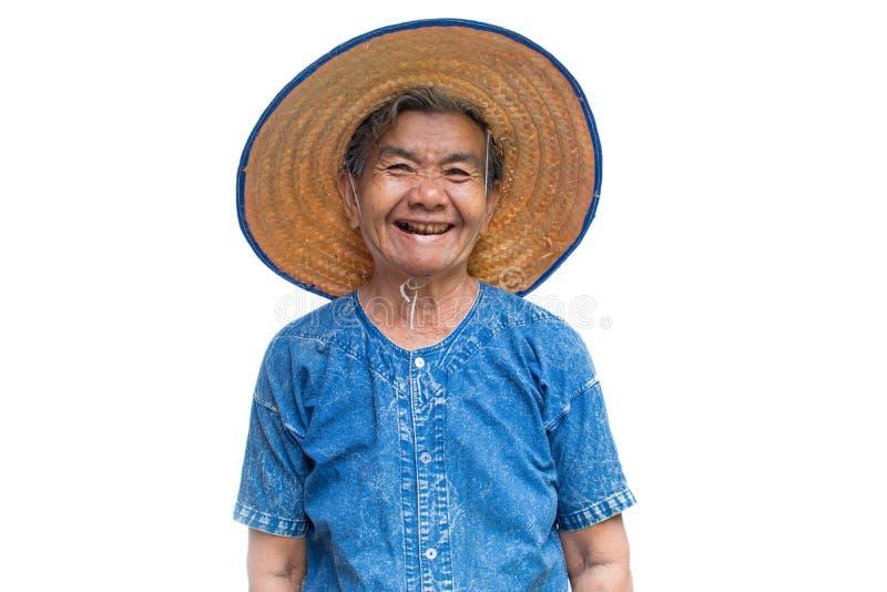 Gelukkige oude Aziatische vrouwenlandbouwer die op een wit glimlachen royalty-vrije stock foto