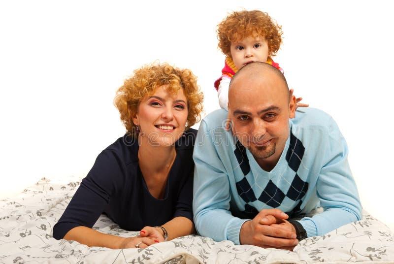Gelukkige ouders en hun dochter royalty-vrije stock afbeeldingen
