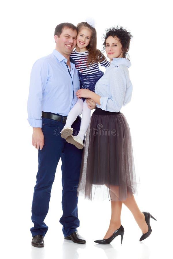 Gelukkige ouders met een kleine dochter royalty-vrije stock afbeelding