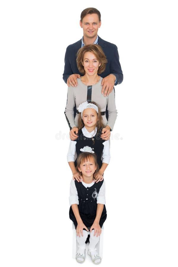 Gelukkige ouders met kinderen stock fotografie