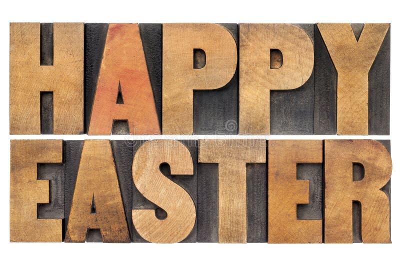 Gelukkige Pasen in houten type stock fotografie