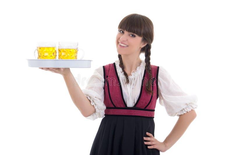 Gelukkige serveerster in Beierse kleding met bier stock foto