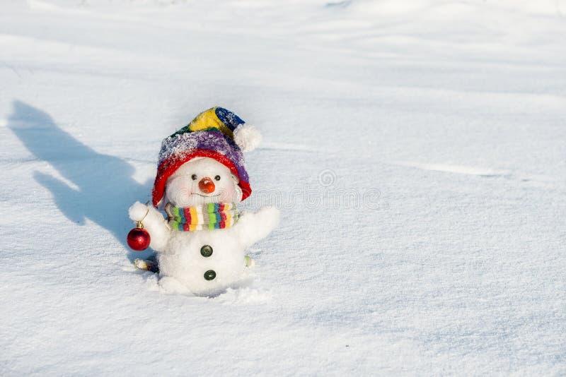 Gelukkige sneeuwman met hoed stock afbeelding