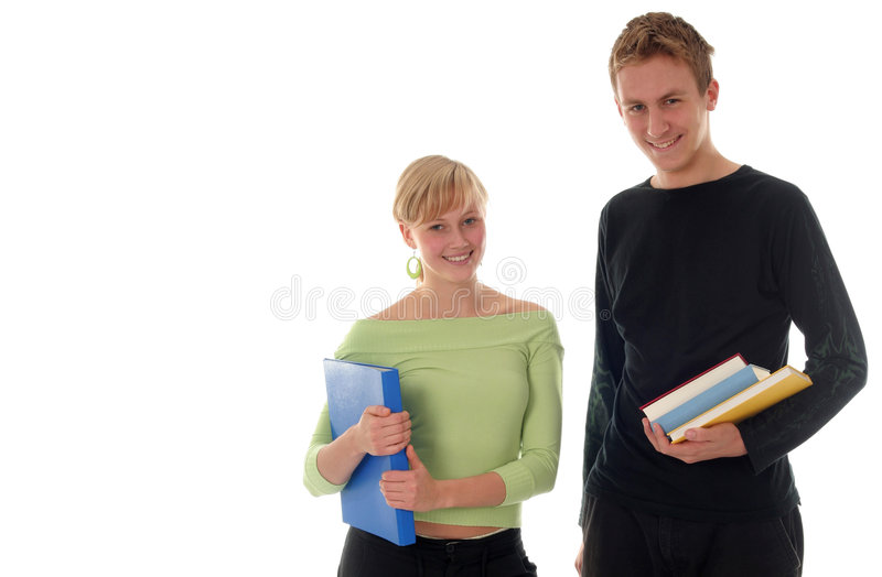 Gelukkige studenten met boeken stock foto