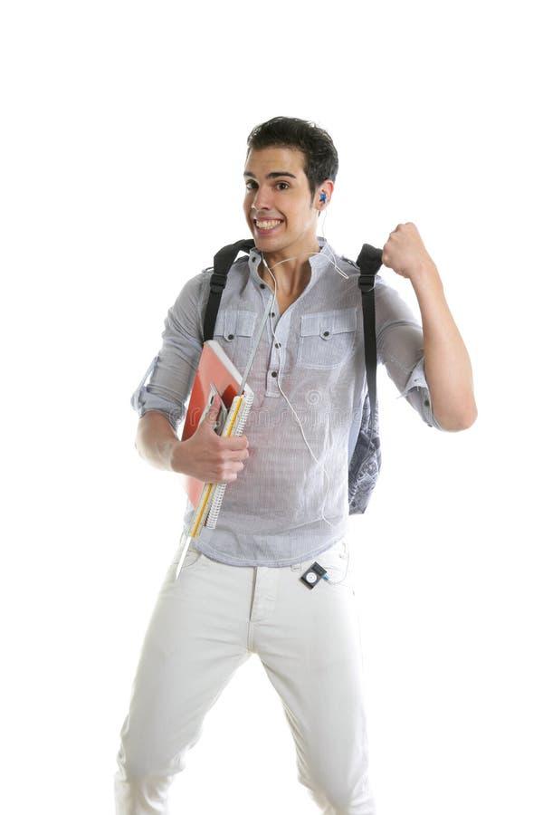Gelukkige studentensprong met universiteitsmateriaal ter beschikking stock foto's