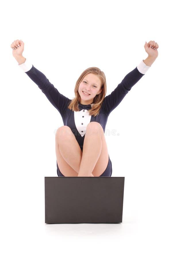 Gelukkige studententiener met laptop stock foto's