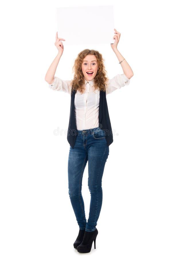 Gelukkige succesvolle bedrijfsvrouw in van gemiddelde lengte met leeg le stock fotografie