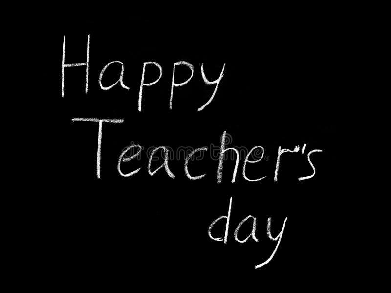 Gelukkige Teacher& x27; s dag - witte inschrijving op een zwarte raad, handdrawn typografieaffiche Vector illustratie royalty-vrije stock foto
