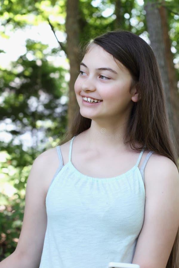 Gelukkige Tiener met Celtelefoon stock foto