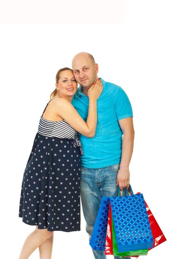 Gelukkige toekomstige ouders bij het winkelen royalty-vrije stock fotografie