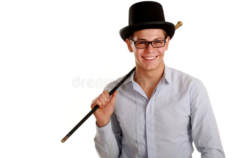 Gelukkige tovenaar op zwarte hoed met toverstokje royalty-vrije stock foto