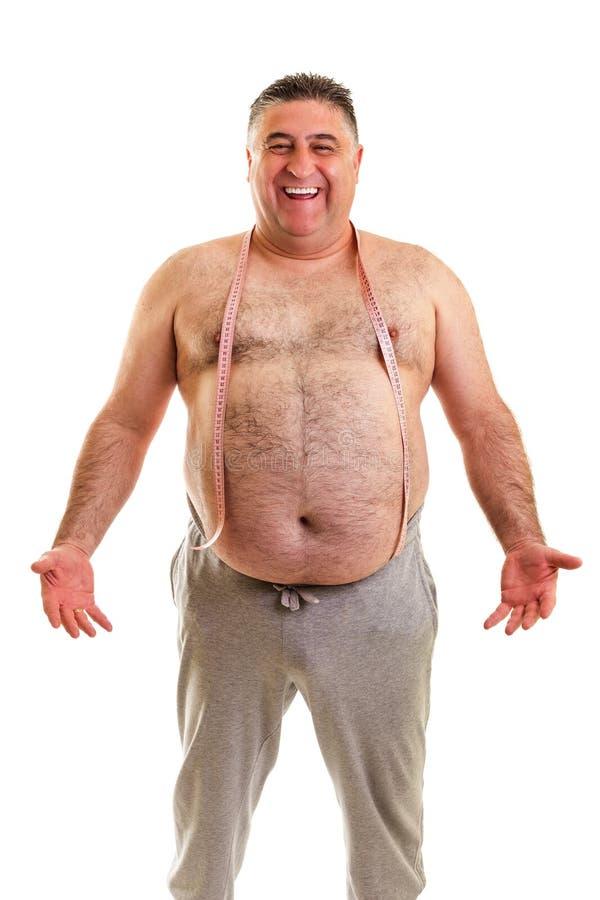Gelukkige vette mens met een meetlint rond zijn hals stock afbeelding