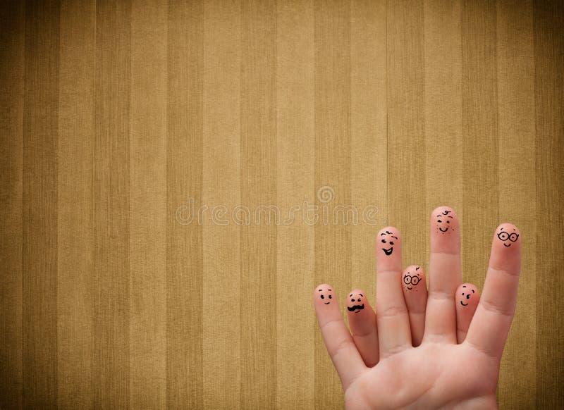 Gelukkige vinger smileys met de uitstekende achtergrond van het streepbehang stock fotografie