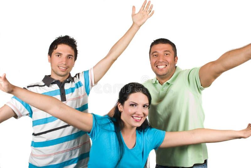 Gelukkige vrienden met omhoog handen royalty-vrije stock afbeelding
