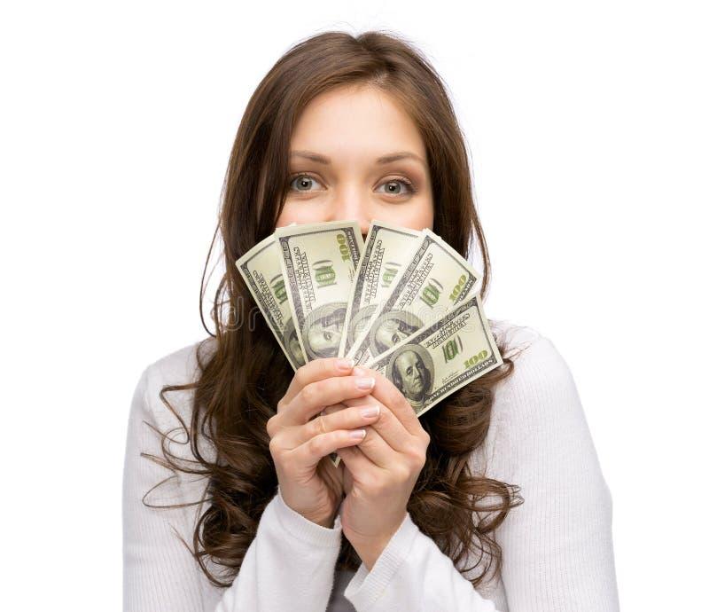 Gelukkige vrouw die geld overhandigen stock afbeeldingen