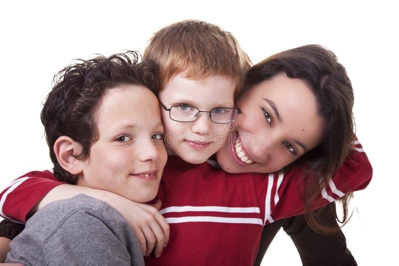 Gelukkige vrouw en kinderen stock foto's