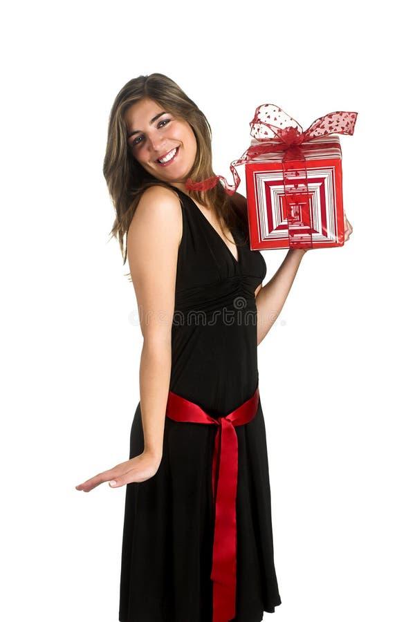 Gelukkige vrouw met een gift stock afbeeldingen