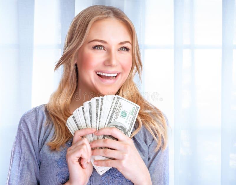 Gelukkige vrouw met partij van geld royalty-vrije stock afbeelding