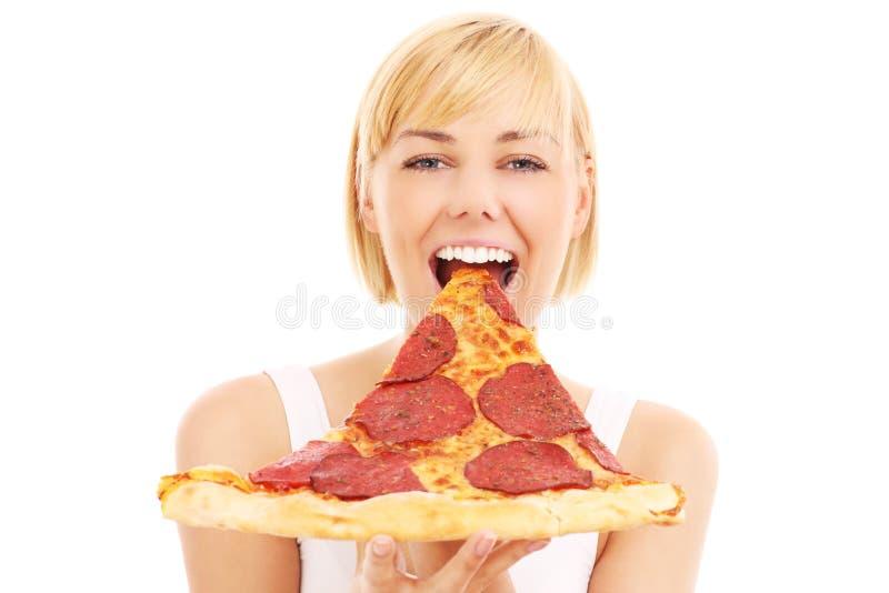 Gelukkige vrouw met pizza stock afbeeldingen