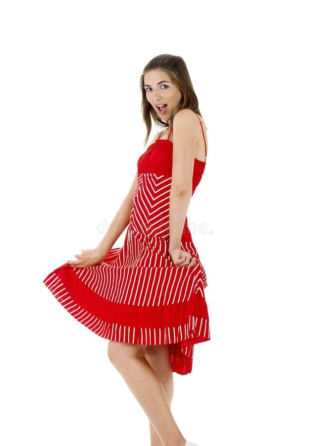 Gelukkige vrouw in rood stock foto