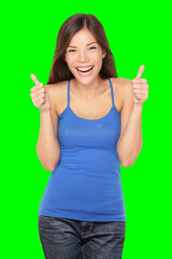 Gelukkige vrouwenduimen omhoog op wit stock foto's