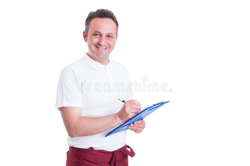 Gelukkige winkelbediende of slager die een controlelijst maken stock foto's