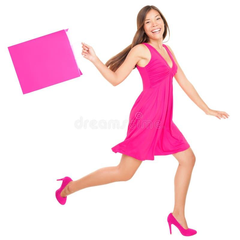 Gelukkige winkelende vrouw stock foto
