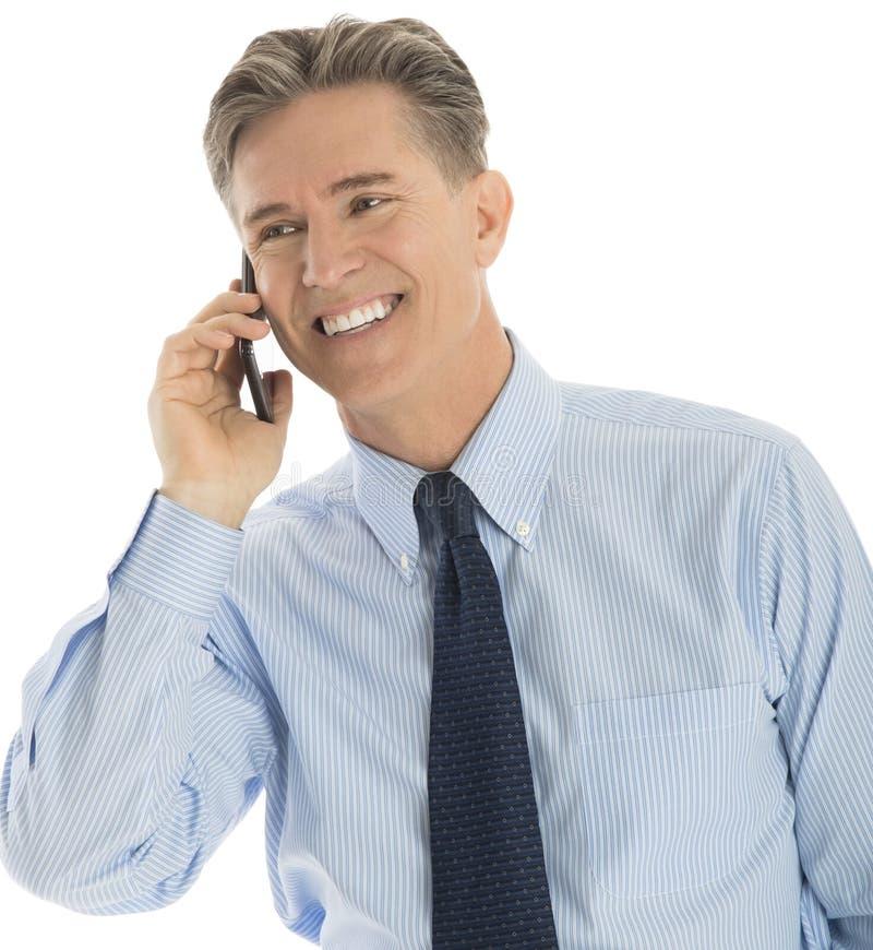 Gelukkige Zakenman Answering Smart Phone royalty-vrije stock foto's