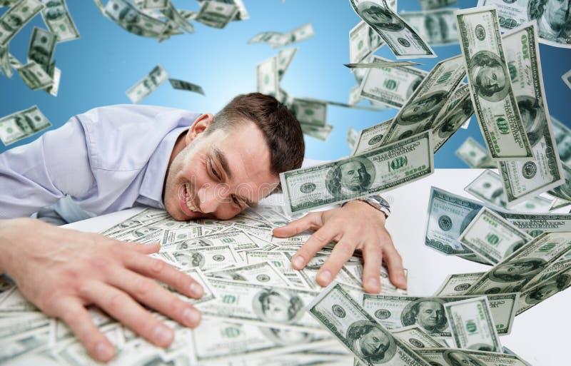 Gelukkige zakenman met hoop van geld royalty-vrije stock foto