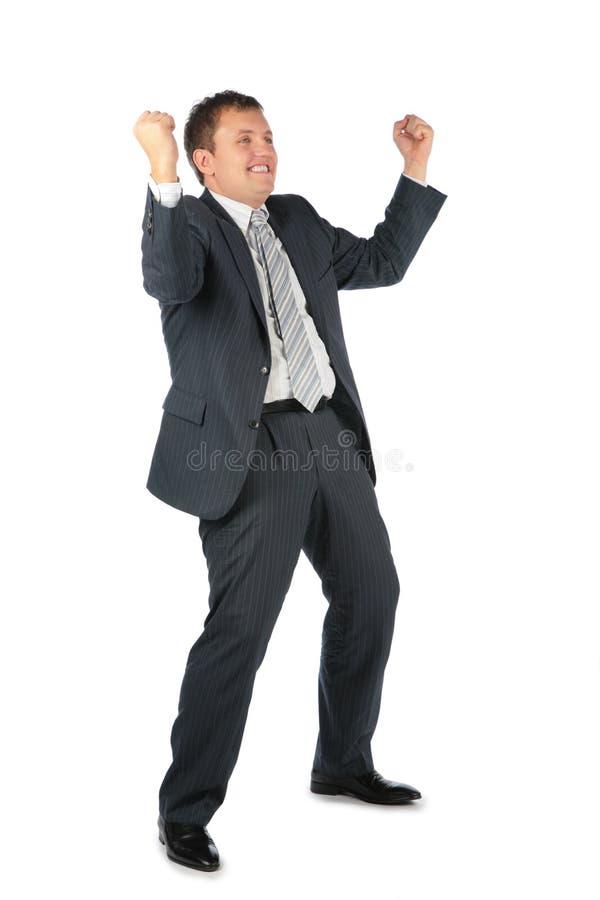 Gelukkige zakenman met omhoog handen stock foto