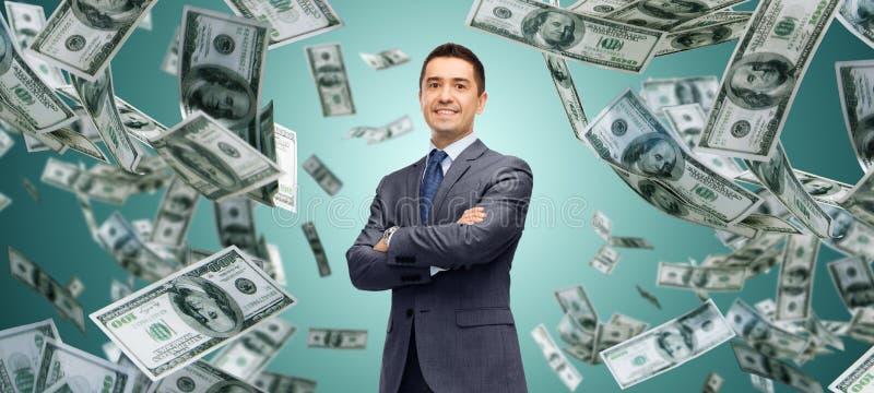 Gelukkige zakenman over het geldregen van het dollarcontante geld stock foto's