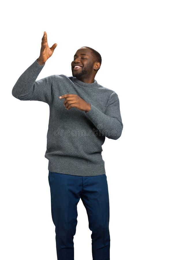 Gelukkige zwarte mens die richting tonen royalty-vrije stock foto