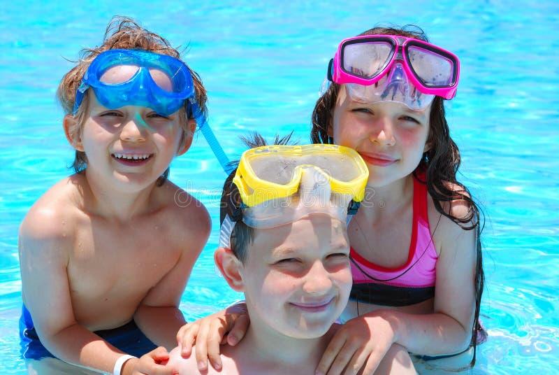 Gelukkige zwemmers royalty-vrije stock foto's
