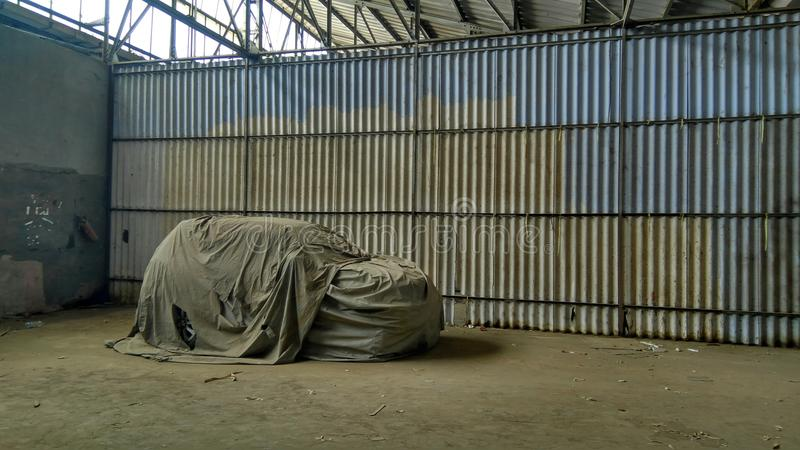 Gem in a abandoned place. Gem a car covered with dust in a abandoned place royalty free stock photo