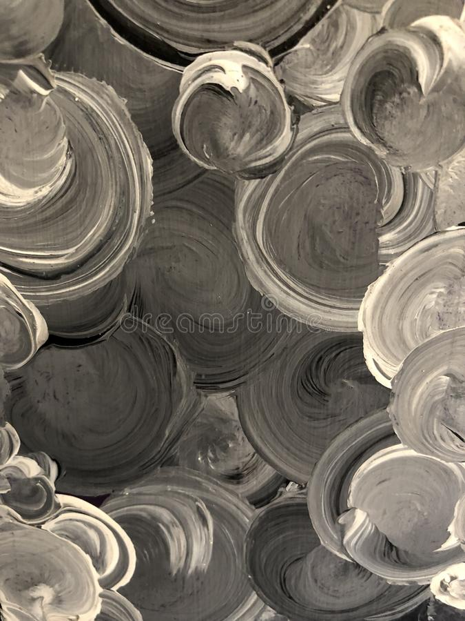 Gemalte Kreise im Grau und im Schwarzen stockbilder