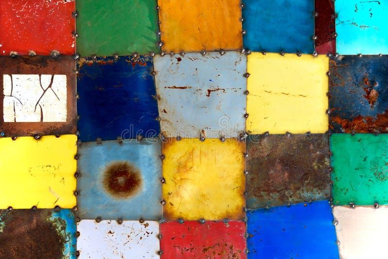 Gemalte Metallquadrate stockbilder