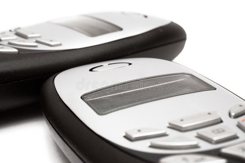 Gemelos del â de los teléfonos celulares foto de archivo